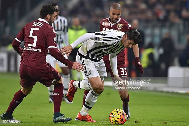 Alvaro Morata of FC Juventus is challenged by Cesare Bovo of Torino FC during the TIM Cup match between FC Juventus and Torino FC at Juventus Arena...