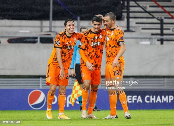 Alvaro Morata of Juventus celebrates after scoring his sides second goal with his team mates during the UEFA Champions League Group G stage match...