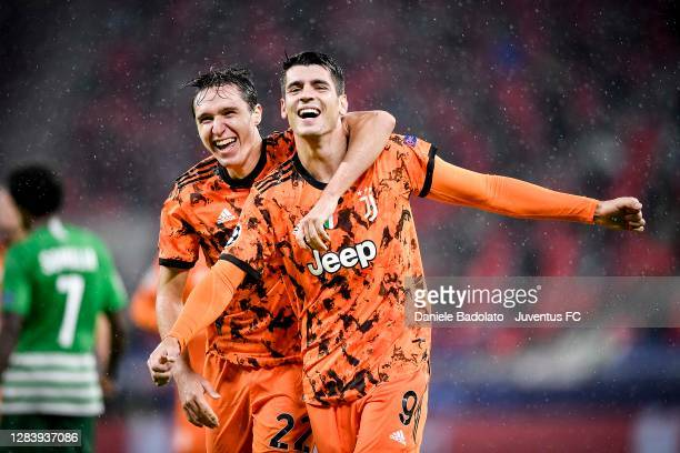 Alvaro Morata of Juventus celebrates after scoring his team's second goal with teammate Federico Chiesa during the UEFA Champions League Group G...