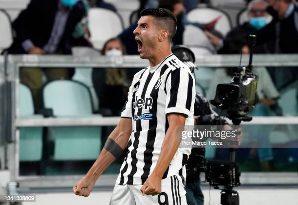 Alvaro Morata of Juventus celebrates after scoring their side's first goal during the Serie A match between Juventus and AC Milan at the Allianz...