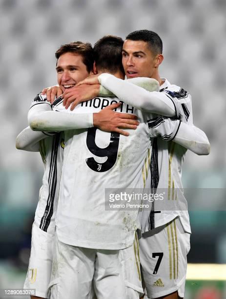 Alvaro Morata of Juventus celebrates after scoring their sides third goal with Federico Chiesa of Juventus and Cristiano Ronaldo of Juventus during...