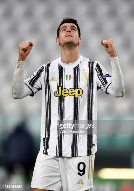 Alvaro Morata of Juventus celebrates after scoring their sides third goal during the UEFA Champions League Group G stage match between Juventus and...