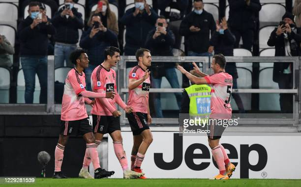 Alvaro Morata of Juventus celebrates goal with teammates Juan Cuadrado of Juventus and Aaron Ramsey of Juventus and Arthur of Juventus before it was...
