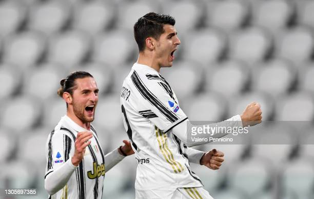 Alvaro Morata of Juventus celebrates with Adrien Rabiot after scoring their team's third goal from the penalty spot during the Serie A match between...
