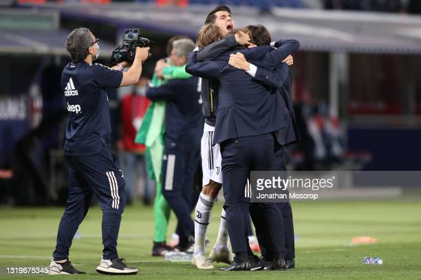 Alvaro Morata of Juventus celebrates with Head coach Andrea Pirlo celebrates following the news from other grounds confirming the club's...