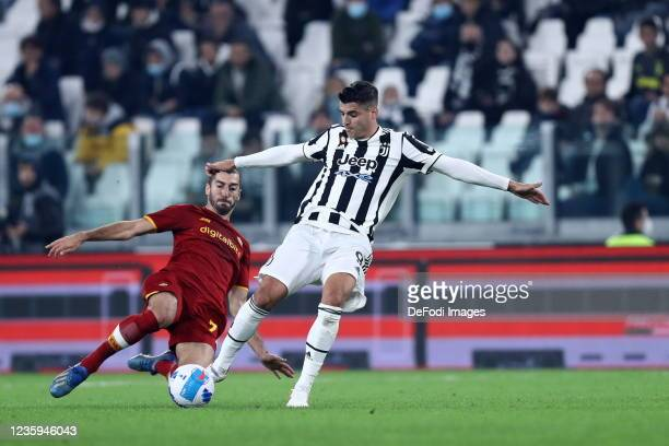 Alvaro Morata of Juventus FC and Henrikh Mkhitaryan of AS Roma battle for the ball during the Serie A match between Juventus and AS Roma at Juventus...
