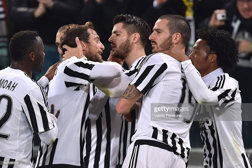 Alvaro Morata (C) of Juventus FC celebrates after scoring the opening goal from the penalty spot with team mates during the TIM Cup match between Juventus FC and FC Internazionale Milano at Juventus Arena on January 27, 2016 in Turin, Italy.