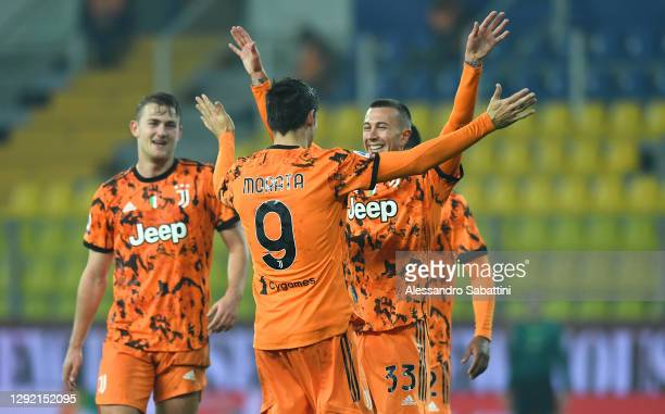 Alvaro Morata of Juventus F.C. Celebrates with Federico Bernardeschi and teammates after scoring their team's fourth goal during the Serie A match...