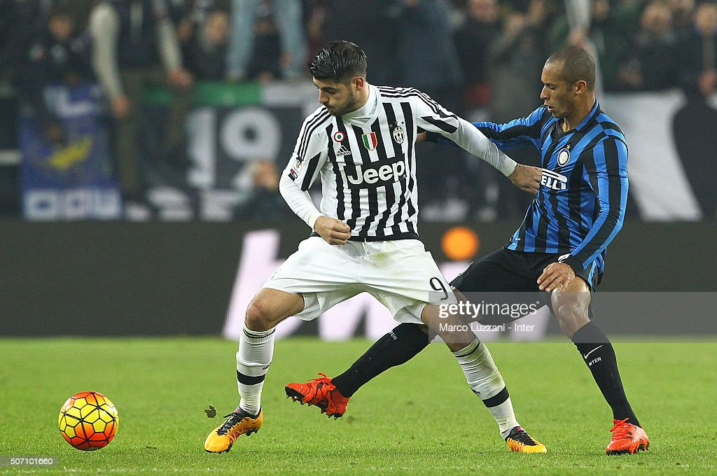 Alvaro Morata of Juventus FC competes for the ball with Joao Miranda of FC Internazionale Milano during the TIM Cup match between Juventus FC and FC Internazionale Milano at Juventus Arena on January 27, 2016 in Turin, Italy.