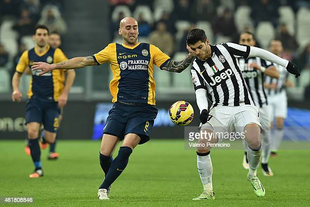 Alvaro Morata of Juventus FC competes with Guillermo Rodriguez of Hellas Verona FC during the Serie A match between Juventus FC and Hellas Verona FC...