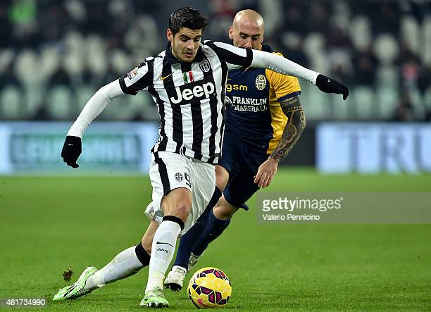 Alvaro Morata of Juventus FC in action against Guillermo Rodriguez of Hellas Verona FC during the Serie A match between Juventus FC and Hellas Verona...