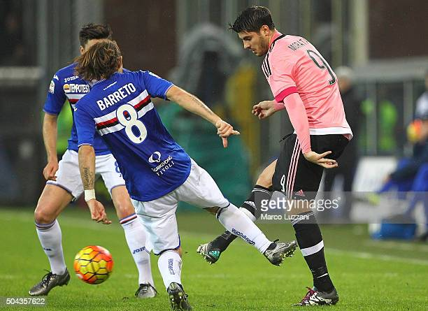 Alvaro Morata of Juventus FC is challenged by Edgar Osvaldo Barreto of UC Sampdoria during the Serie A match between UC Sampdoria and Juventus FC at...