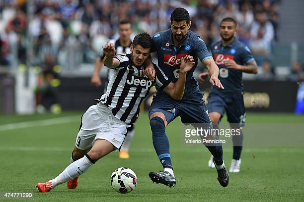 Alvaro Morata of Juventus FC is challenged by Miguel Angel Britos of SSC Napoli during the Serie A match between Juventus FC and SSC Napoli at...