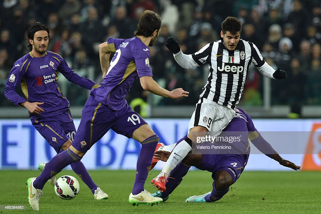 Alvaro Morata (C) of Juventus FC is tackled by Micah Richards (R) of ACF Fiorentina during the TIM Cup match between Juventus FC and ACF Fiorentina at Juventus Arena on March 5, 2015 in Turin, Italy.