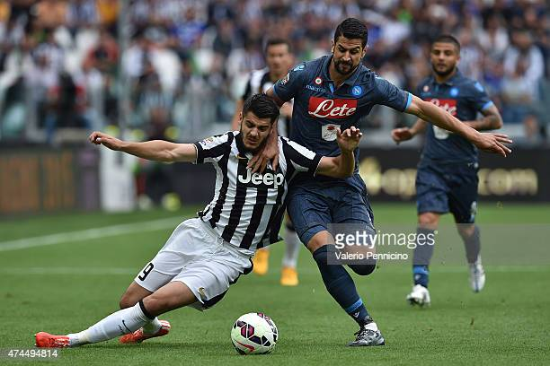 Alvaro Morata of Juventus FC is tackled by Miguel Angel Britos of SSC Napoli during the Serie A match between Juventus FC and SSC Napoli at Juventus...