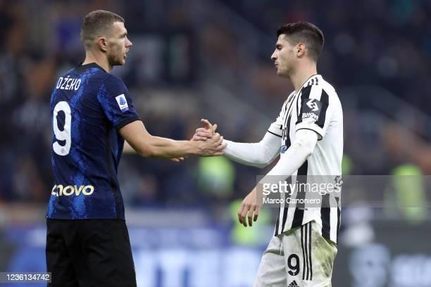 Alvaro Morata of Juventus Fc shakes hands with Edin Dzeko of Fc Internazionale at the end of the Serie A match between Fc Internazionale and Juventus...