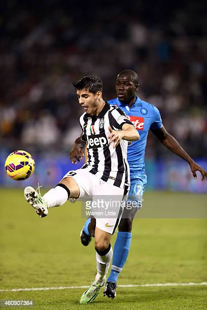 Alvaro Morata of Juventus in action during the 2014 Italian Super Cup match between Juventus FC v SSC Napoli at the Jassim Bin Hamad Stadium on...