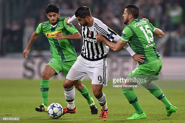 Alvaro Morata of Juventus is challenged by Alvaro Dominguez of VfL Borussia Moenchengladbach during the UEFA Champions League group stage match...