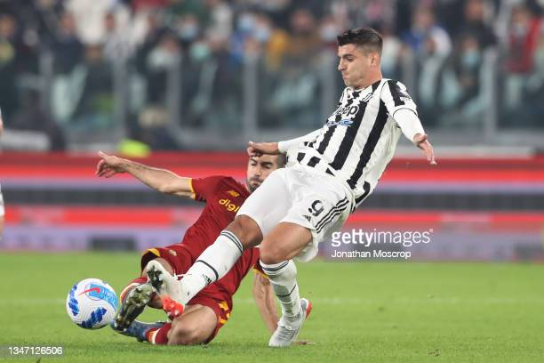 Alvaro Morata of Juventus is challenged by Henrikh Mkhitaryan of AS Roma during the Serie A match between Juventus and AS Roma at on October 17, 2021...