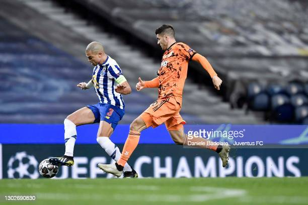 Alvaro Morata of Juventus is challenged by Kepler Lima 'Pepe' of FC Porto during the UEFA Champions League Round of 16 match between FC Porto and...