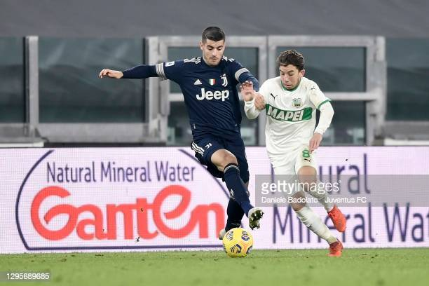 Alvaro Morata of Juventus is challenged by Maxime Lopez of US Sssuolo during the Serie A match between Juventus and US Sassuolo at Allianz Stadium on...