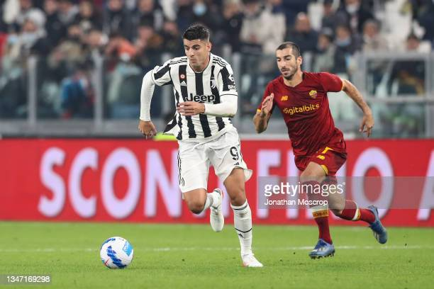 Alvaro Morata of Juventus is pursued by Henrikh Mkhitaryan of AS Roma during the Serie A match between Juventus and AS Roma at Allianz Stadium on...
