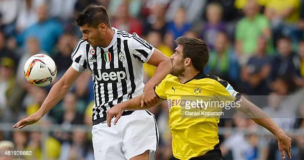 Alvaro Morata of Juventus jumps for a header with Henrikh Mkhitaryan of Dortmund during the friendly match between Juventus and Borussia Dortmund on...