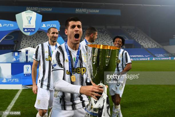 Alvaro Morata of Juventus poses for a photo with the PS5 Supercup following their side's victory in the Italian PS5 Supercup match between Juventus...