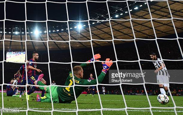 Alvaro Morata of Juventus scores past MarcAndre ter Stegen of Barcelona for his team's first goal during the UEFA Champions League Final between...