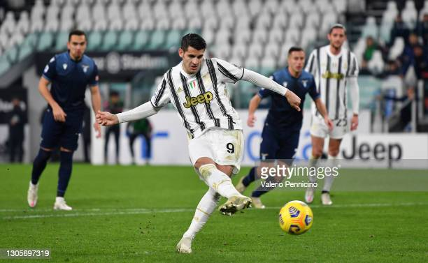 Alvaro Morata of Juventus scores their team's third goal from the penalty spot during the Serie A match between Juventus and SS Lazio at Allianz...