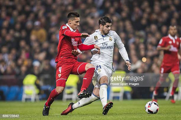 Alvaro Morata of Real Madrid battles for the ball with Matias Kranevitter of Sevilla FC during their Copa del Rey Round of 16 match between Real...