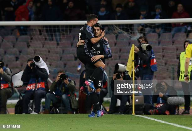 Alvaro Morata of Real Madrid celebrates after scoring his team's third goal during the UEFA Champions League Round of 16 second leg match between SSC...
