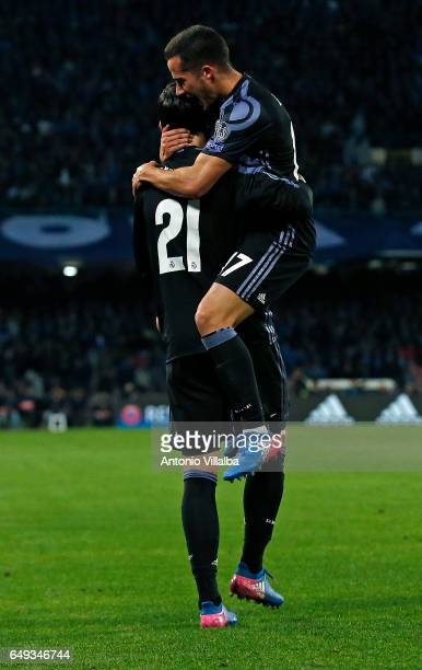 Alvaro Morata of Real Madrid celebrates whit Lucas Vazquez the third goal of his team during the UEFA Champions League Round of 16 second leg match...