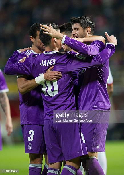 Alvaro Morata of Real Madrid celebrates with his teammates Marco Asensio and James Rodriguez of Real Madrid after scoring his team's fifth goal...