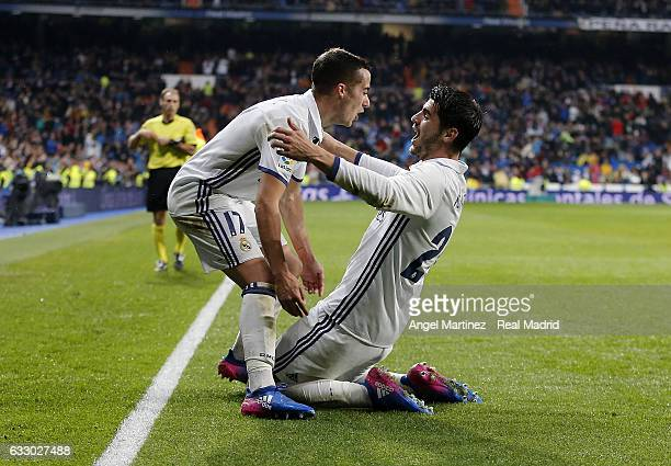 Alvaro Morata of Real Madrid celebrates with Lucas Vazquez after scoring their team's third goal during the La Liga match between Real Madrid and...