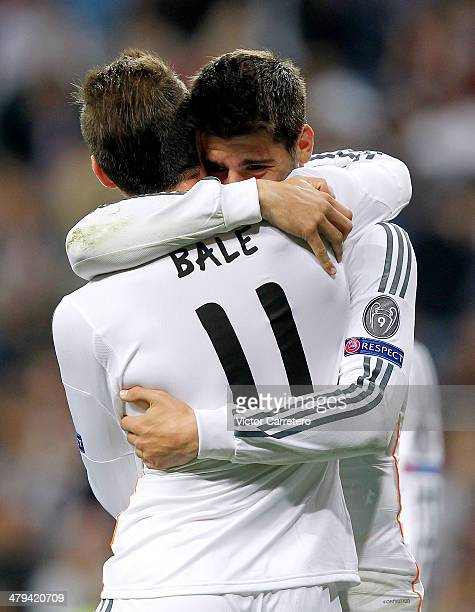 Alvaro Morata of Real Madrid celebrates with teammate Gareth Bale after scoring his team's third goal during the UEFA Champions League Round of 16...