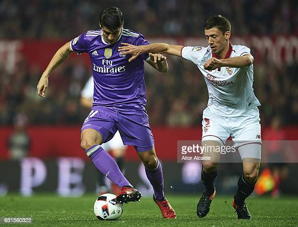 Alvaro Morata of Real Madrid CF being followed by Clement Lenglet of Sevilla FC during the Copa del Rey Round of 16 Second Leg match between Sevilla...