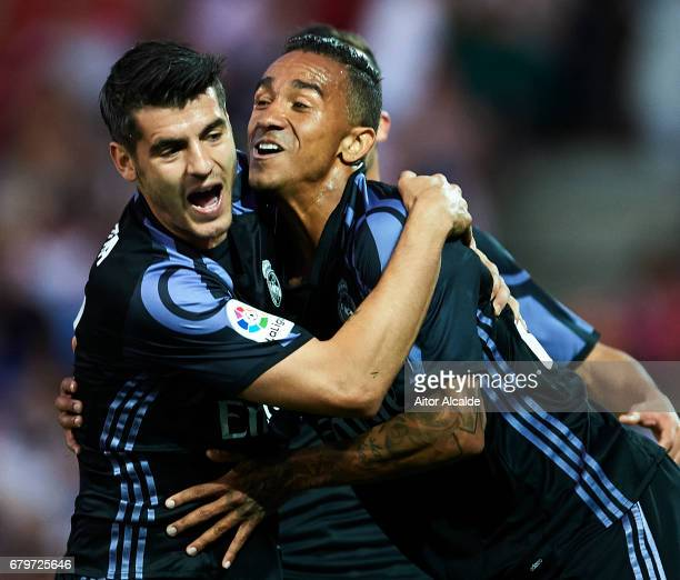 Alvaro Morata of Real Madrid CF celebrates after scoring the second goal with Danilo of Real Madrid CF during the La Liga match between Granada CF v...