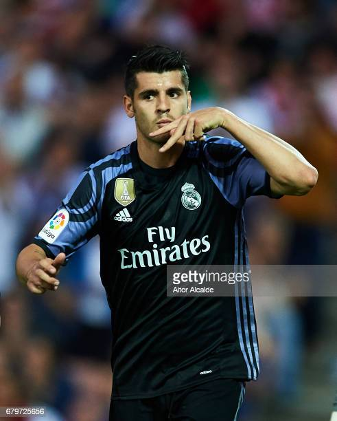 Alvaro Morata of Real Madrid CF celebrates after scoring the second goal during the La Liga match between Granada CF v Real Madrid CF at Estadio...