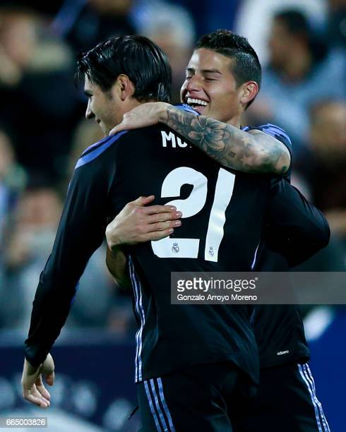 Alvaro Morata of Real Madrid CF celebrates scoring their fourth goal with teammate James Rodriguez during the La Liga match between CD Leganes and...