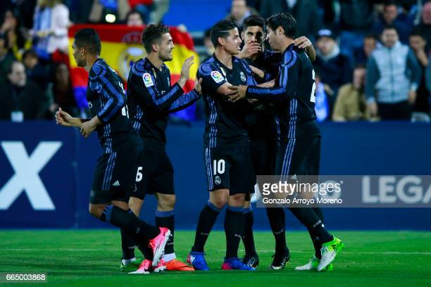 Alvaro Morata of Real Madrid CF celebrates scoring their fourth goal with teammates during the La Liga match between CD Leganes and Real Madrid CF at...
