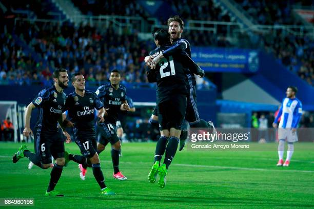 Alvaro Morata of Real Madrid CF celebrates scoring their second goal with teammate Sergio Ramos during the La Liga match between CD Leganes and Real...