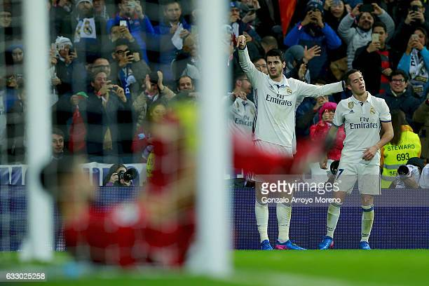 Alvaro Morata of Real Madrid CF celebrates scoring their third goal with teammate Lucas Vazquez during the La Liga match between Real Madrid CF and...