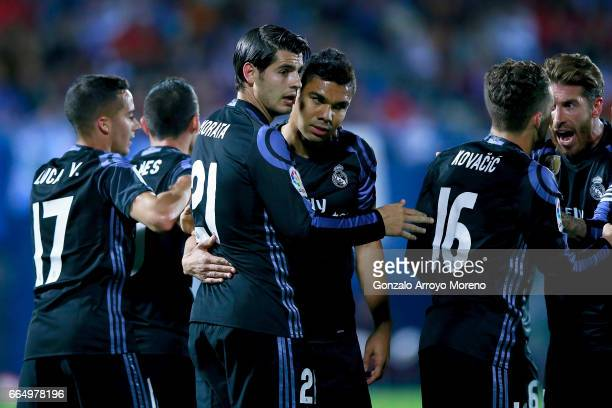 Alvaro Morata of Real Madrid CF celebrates scoring their third goal with teammates Carlos Casemiro Mateo Kovacic and Sergio Ramos during the La Liga...