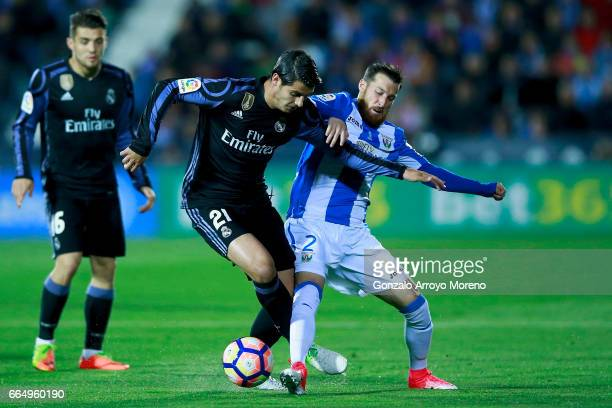 Alvaro Morata of Real Madrid CF competes for the ball with Roberto Roman Triguero alias Tito of Deportivo Leganes during the La Liga match between CD...