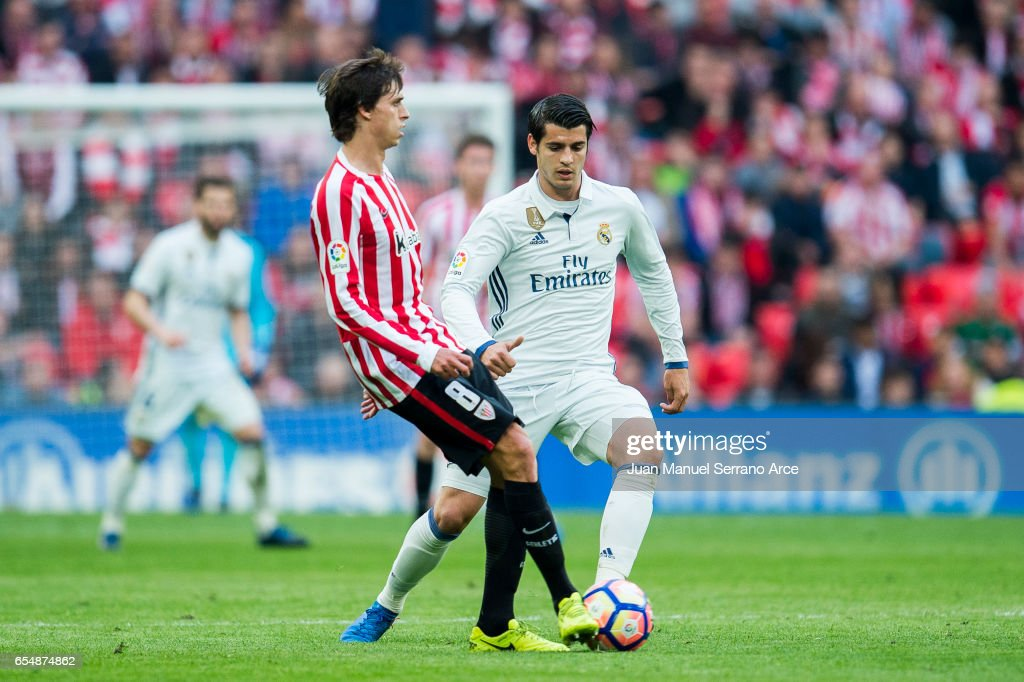 Alvaro Morata of Real Madrid competes for the ball with Ander Iturraspe of Athletic Club during the La Liga match between Athletic Club Bilbao and Real Madrid at San Mames Stadium on on March 18, 2017 in Bilbao, Spain.