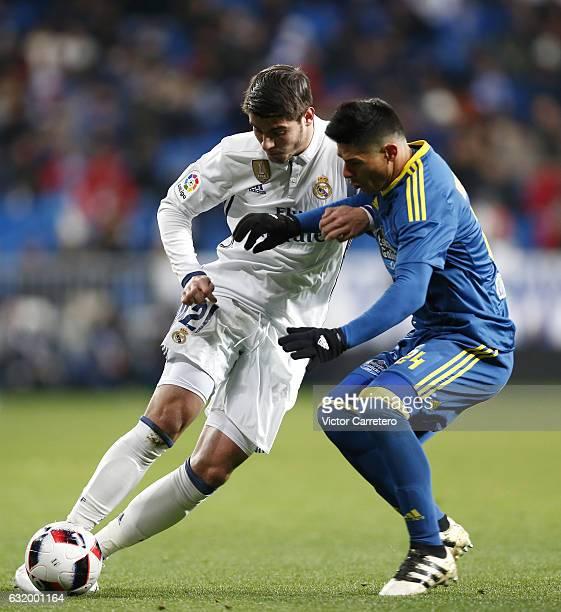 Alvaro Morata of Real Madrid competes for the ball with Facundo Roncaglia of Celta de Vigo during the Copa del Rey quarterfinal first leg match...