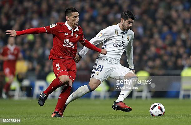 Alvaro Morata of Real Madrid competes for the ball with Matias Kranevitter of Sevilla during the Copa del Rey round of 16 first leg match between...
