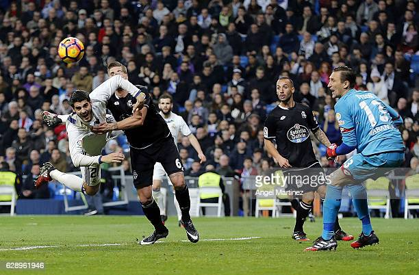 Alvaro Morata of Real Madrid competes for the ball with Raul Albentosa of Deportivo La Coruna during the La Liga match between Real Madrid CF and RC...