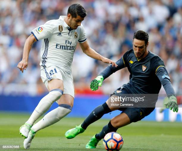 Alvaro Morata of Real Madrid competes for the ball with Sergio Rico of Sevilla during the La Liga match between Real Madrid and Sevilla FC at Estadio...